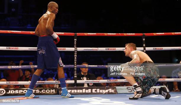 Ricky Burns and Julius Indongo during the WBA IBF and IBO Superlightweight World Championship bout at the SSE Hydro Glasgow