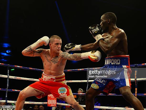 Ricky Burns and Terence Crawford clash during the WBO World Lightweight Championship Boxing match at the Glasgow SECC on March 1 2014 in Glasgow...