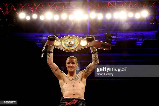 Ricky Burns celebrates his victory over Jose Gonzalez during their World WBO Lightweight Championship bout at Emirates Arena on May 11 2013 in...