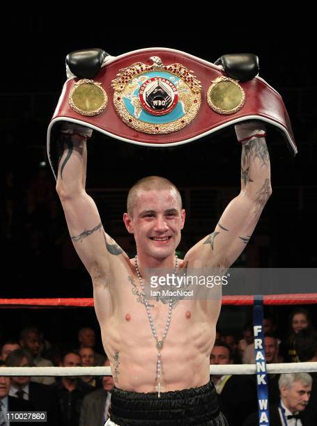 Ricky Burns defeats Joseph Laryea to retain the WBO Super Featherweight Championship of The World contest at the Braehead Arena on December 12 2011...