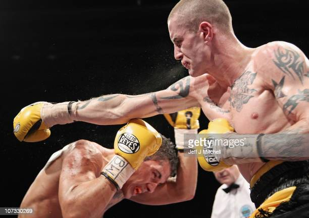 Ricky Burns fights Andreas Eversen during the WBO Super Featherweight Championship of The World contest at the Braehead Arena on December 4 2010 in...