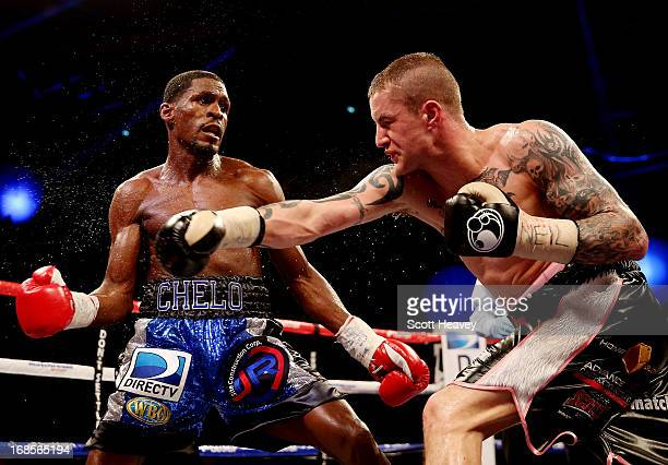 Ricky Burns in action with Jose Gonzalez during their World WBO Lightweight Championship bout at Emirates Arena on May 11 2013 in Glasgow Scotland