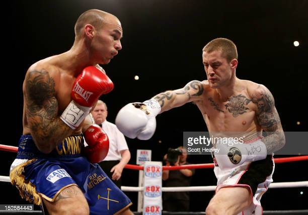 Ricky Burns in action with Kevin Mitchell during the WBO World Lightweight Championship match at SECC on September 22 2012 in Glasgow Scotland