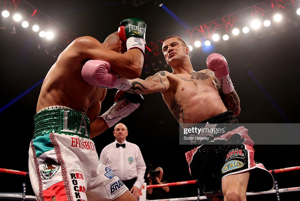 <a gi-track='captionPersonalityLinkClicked' href=/galleries/search?phrase=Ricky+Burns&family=editorial&specificpeople=4145249 ng-click='$event.stopPropagation()'>Ricky Burns</a> in action with Raymundo Beltran during their WBO World Lightweight Title bout at SECC on September 7, 2013 in Glasgow, Scotland.