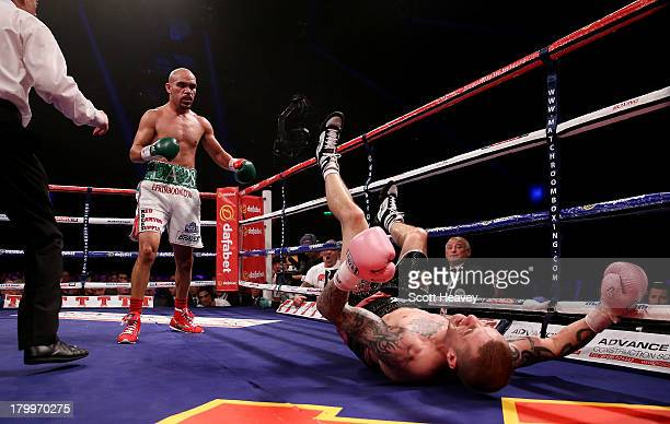Ricky Burns in action with Raymundo Beltran during their WBO World Lightweight Title bout at SECC on September 7 2013 in Glasgow Scotland