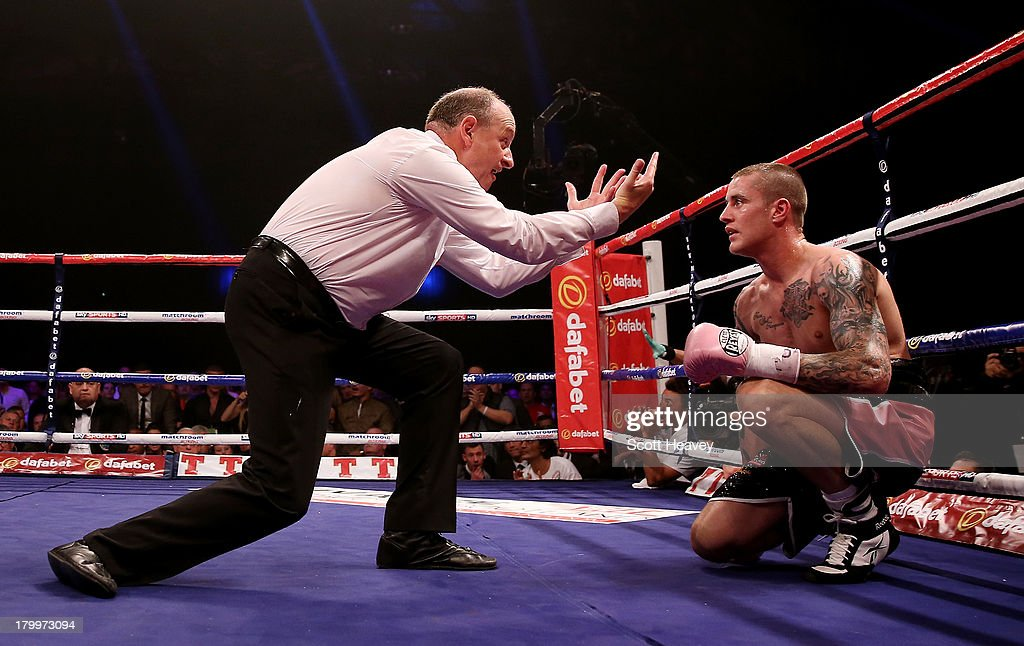 <a gi-track='captionPersonalityLinkClicked' href=/galleries/search?phrase=Ricky+Burns&family=editorial&specificpeople=4145249 ng-click='$event.stopPropagation()'>Ricky Burns</a> is given a count after being knocked down by Raymundo Beltran during their WBO World Lightweight Title bout at SECC on September 7, 2013 in Glasgow, Scotland.