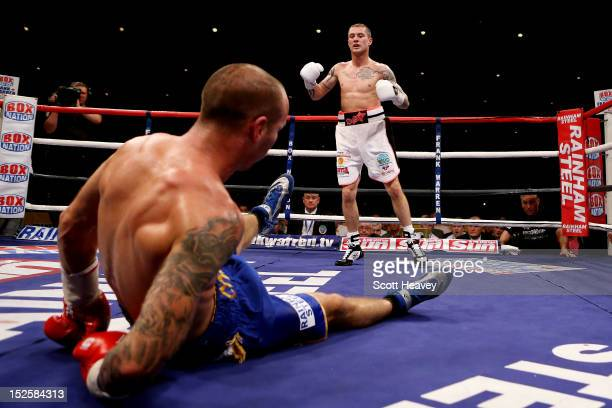 Ricky Burns knocks down Kevin Mitchell during the WBO World Lightweight Championship match at SECC on September 22 2012 in Glasgow Scotland
