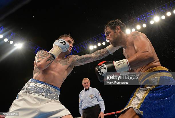 Ricky Burns of Scotland and Michele Di Rocco of Italy during the WBA world superlightweight title fight at The SSE Hydro on May 28 2016 in Glasgow...
