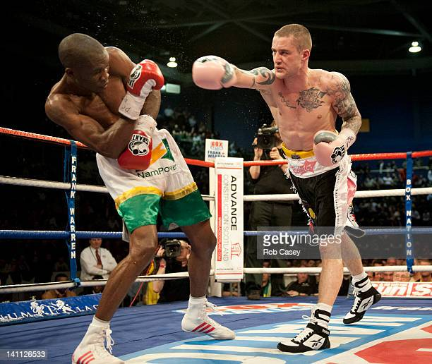Ricky Burns of Scotland exchanges blows with Paulus Moses of Namibia during the WBO world lightweight title fight at the Braehead Arena on March 10...
