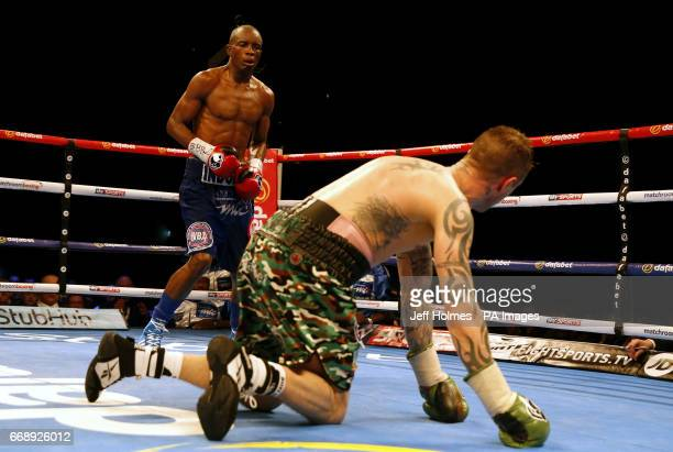 Ricky Burns on his knees against Julius Indongo during the WBA IBF and IBO Superlightweight World Championship bout at the SSE Hydro Glasgow
