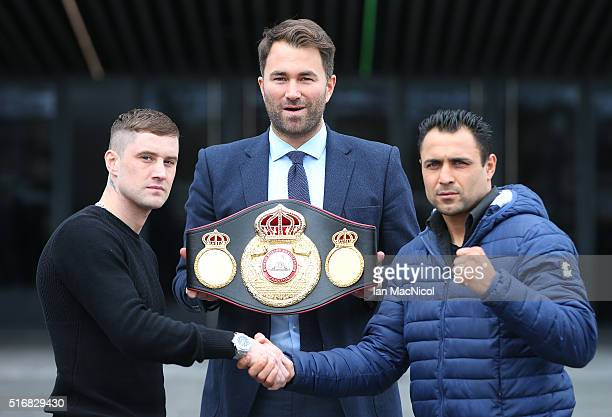 Ricky Burns poses with Michele Di Rocco as Eddie Hearns looks on during the Ricky Burns and Michele Di Rocco Press Conference at The SSEC on March 21...