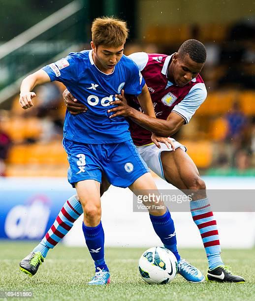Ricky Calder of Aston Villa and Wong Chin Hung of BC Rangers fight for the ball on day two of the Hong Kong International Soccer Sevens at Hong Kong...