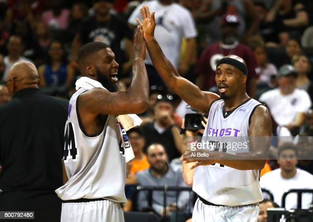 Ricky Davis and Ivan Johnson of the Ghost Ballers react late in the game against the 3 Headed Monsters during week one of the BIG3 three on three...