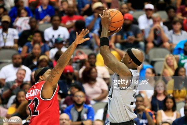 Ricky Davis of the Ghost Ballers attempts a shot while being guarded by Rashad McCants of Trilogy during week six of the BIG3 three on three...