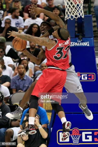 Ricky Davis of the Ghost Ballers passes the ball while being guarded by Rashad McCants of Trilogy during week six of the BIG3 three on three...