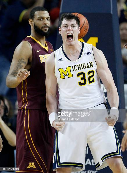Ricky Doyle of the Michigan Wolverines celebrates after scoring against Maurice Walker of the Minnesota Golden Gophers during the second half at...