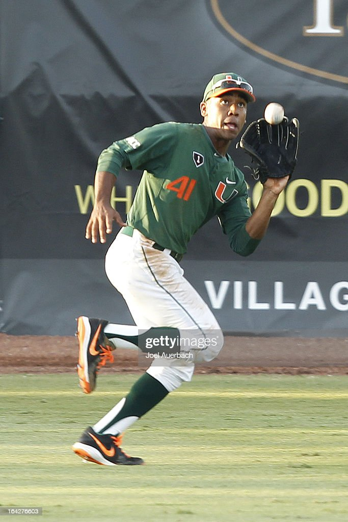 Ricky Eusebio #41 of the Miami Hurricanes catches the ball hit by Nick Maguire #30 (not pictured) of the Columbia Lions for the final out of the third inning on March 19, 2013 at Alex Rodriguez Park at Mark Light Field in Coral Gables, Florida. Miami defeated Columbia 9-6.