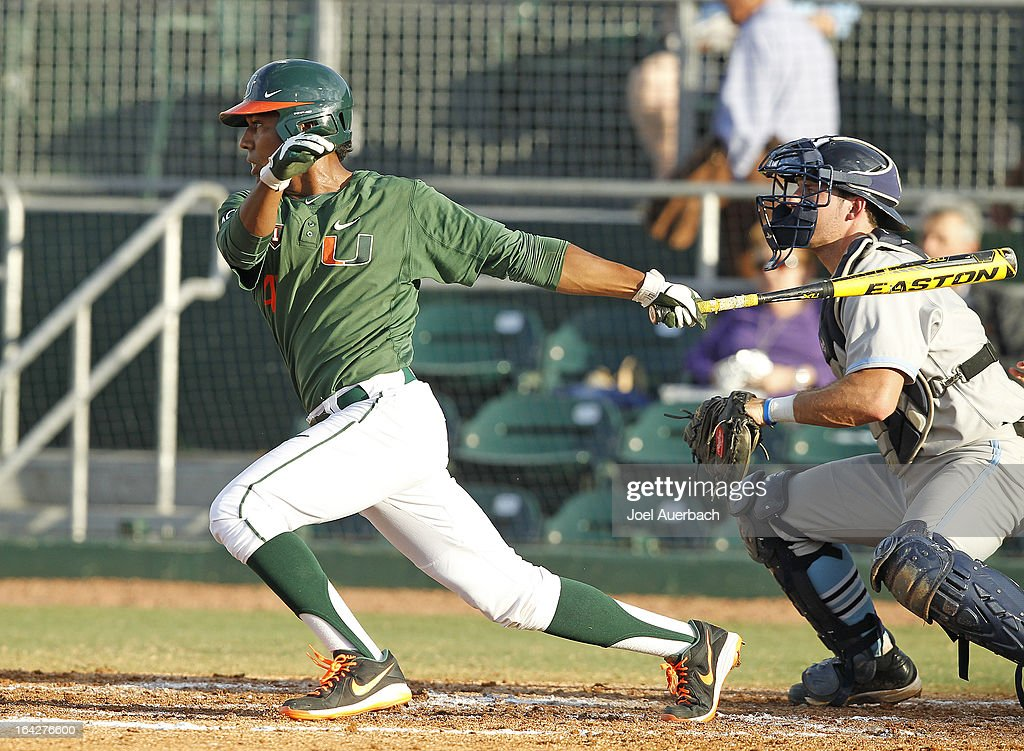 Ricky Eusebio #41 of the Miami Hurricanes hits the ball against the Columbia Lions on March 19, 2013 at Alex Rodriguez Park at Mark Light Field in Coral Gables, Florida. Miami defeated Columbia 9-6.