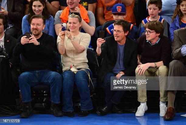 Ricky Gervais Jane Fallon Michael J Fox and Sam Michael Fox attend the Boston Celtics vs New York Knicks Playoff Game at Madison Square Garden on...