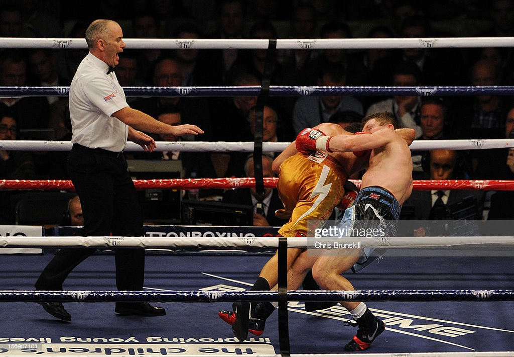 Ricky Hatton of Great Britain and Vyacheslav Senchenko of Ukraine fall to the canvas during their welterweight bout at MEN Arena on November 24, 2012 in Manchester, England.