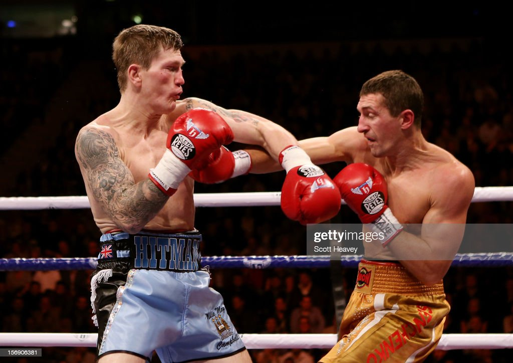 <a gi-track='captionPersonalityLinkClicked' href=/galleries/search?phrase=Ricky+Hatton&family=editorial&specificpeople=208674 ng-click='$event.stopPropagation()'>Ricky Hatton</a> of Great Britain (L) in action with Vyacheslav Senchenko of Ukraine during their Welterweight bout at the MEN Arena on November 24, 2012 in Manchester, England.