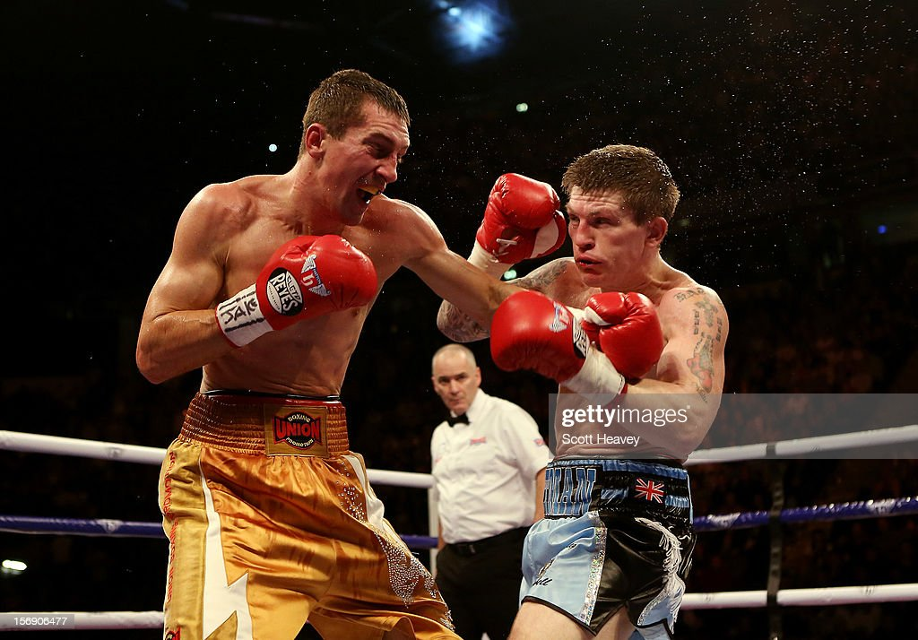 Ricky Hatton of Great Britain (R) in action with Vyacheslav Senchenko of Ukraine during their Welterweight bout at the MEN Arena on November 24, 2012 in Manchester, England.