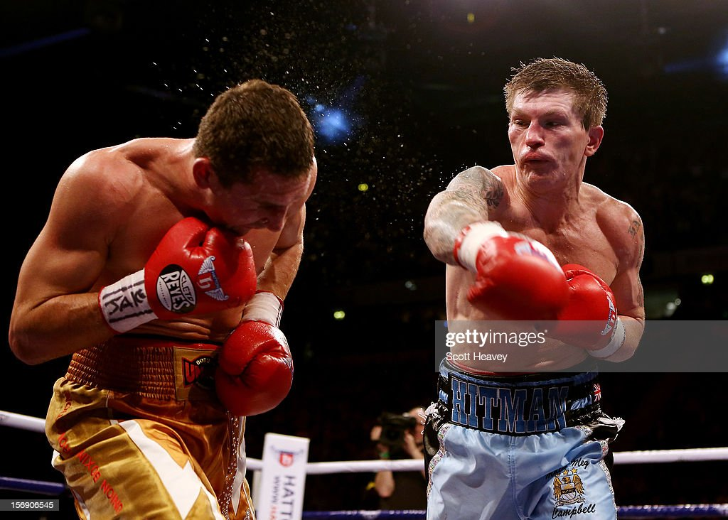 <a gi-track='captionPersonalityLinkClicked' href=/galleries/search?phrase=Ricky+Hatton&family=editorial&specificpeople=208674 ng-click='$event.stopPropagation()'>Ricky Hatton</a> of Great Britain in action with Vyacheslav Senchenko of Ukraine during their Welterweight bout at the MEN Arena on November 24, 2012 in Manchester, England.