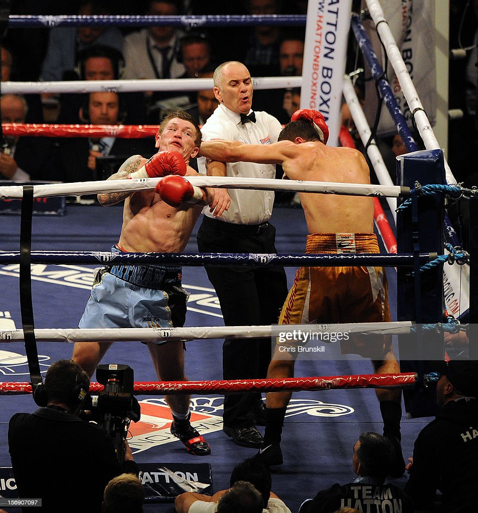 Ricky Hatton (L) of Great Britain in action with Vyacheslav Senchenko of Ukraine during their welterweight bout at MEN Arena on November 24, 2012 in Manchester, England.