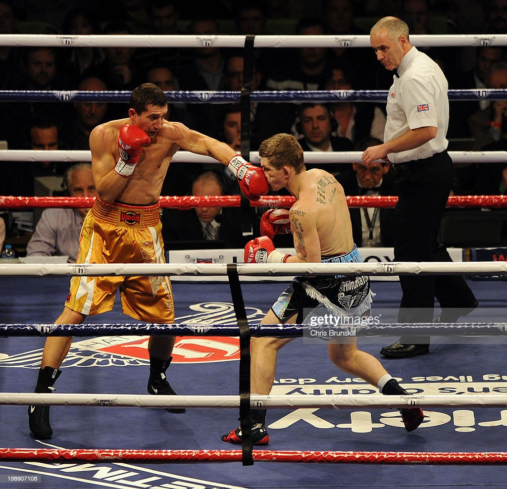 Ricky Hatton (R) of Great Britain in action with Vyacheslav Senchenko of Ukraine during their welterweight bout at MEN Arena on November 24, 2012 in Manchester, England.