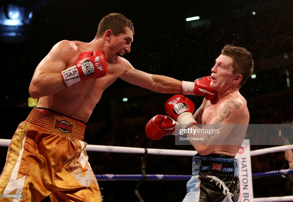 <a gi-track='captionPersonalityLinkClicked' href=/galleries/search?phrase=Ricky+Hatton&family=editorial&specificpeople=208674 ng-click='$event.stopPropagation()'>Ricky Hatton</a> of Great Britain (R) is caught by Vyacheslav Senchenko of Ukraine during their Welterweight bout at the MEN Arena on November 24, 2012 in Manchester, England.