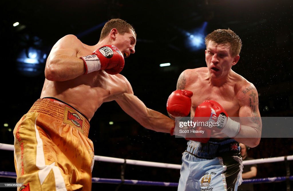 Ricky Hatton of Great Britain (R) is caught by Vyacheslav Senchenko of Ukraine during their Welterweight bout at the MEN Arena on November 24, 2012 in Manchester, England.