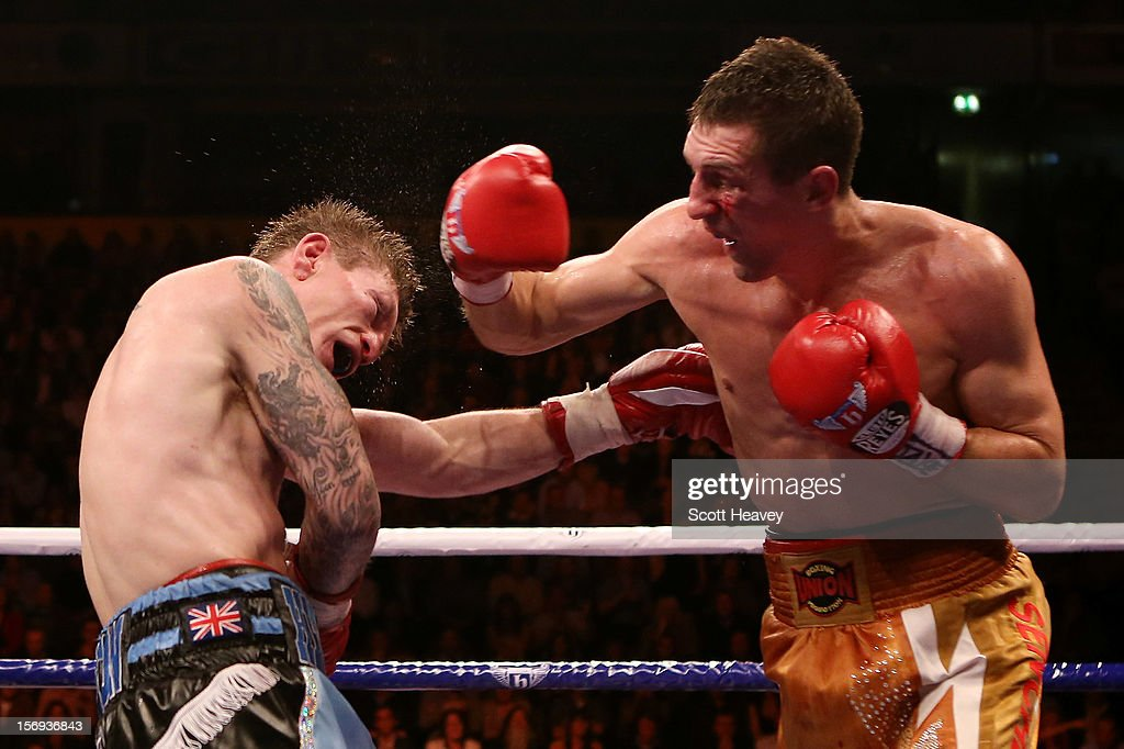 Ricky Hatton of Great Britain (L) is caught by Vyacheslav Senchenko of Ukraine during their Welterweight bout at the MEN Arena on November 24, 2012 in Manchester, England.