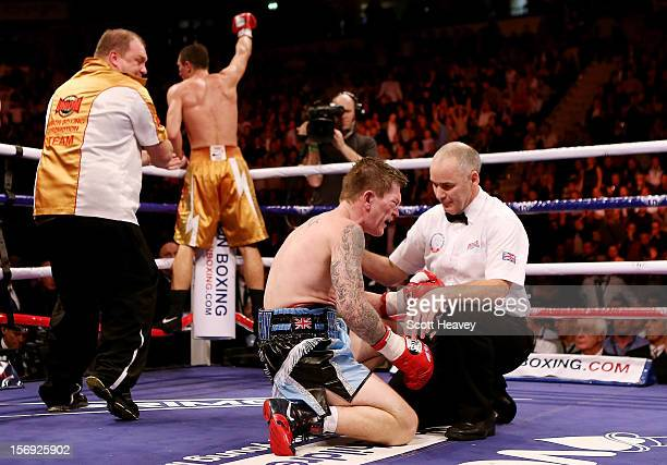 Ricky Hatton of Great Britainfails to get up after being knocked down by Vyacheslav Senchenko of Ukraine during their Welterweight bout at the MEN...
