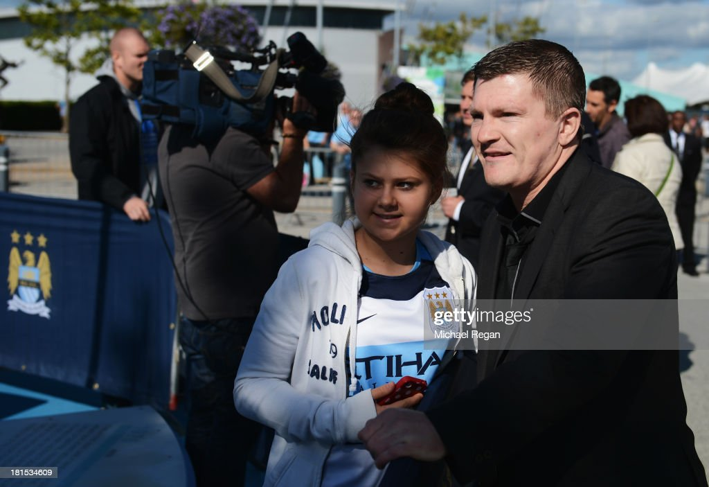 <a gi-track='captionPersonalityLinkClicked' href=/galleries/search?phrase=Ricky+Hatton&family=editorial&specificpeople=208674 ng-click='$event.stopPropagation()'>Ricky Hatton</a> poses for a photograph with fan outside the ground before the Barclays Premier League match between Manchester City and Manchester United at the Etihad Stadium on September 22, 2013 in Manchester, England.
