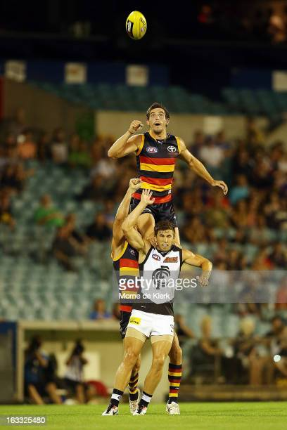 Ricky Henderson of the Crows gets high to spoil the ball during the round three NAB Cup AFL match between the Adelaide Crows and the Carlton Blues at...