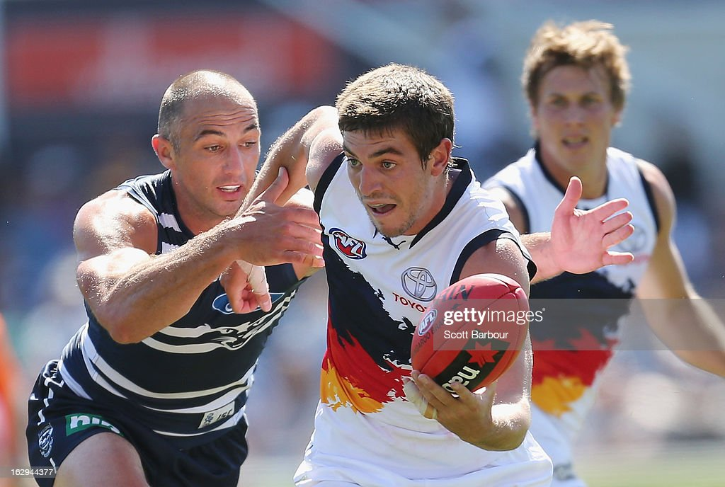 Ricky Henderson of the Crows is tackled by <a gi-track='captionPersonalityLinkClicked' href=/galleries/search?phrase=James+Podsiadly&family=editorial&specificpeople=2327929 ng-click='$event.stopPropagation()'>James Podsiadly</a> of the Cats during the round two AFL NAB Cup match between the Geelong Cats and the Adelaide Crows at Simonds Stadium on March 2, 2013 in Geelong, Australia.