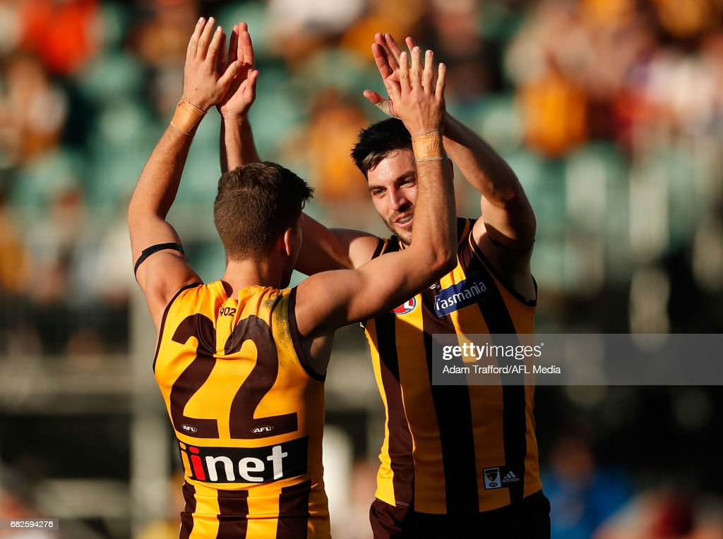 Ricky Henderson of the Hawks (right) celebrates a goal with Luke Breust of the Hawks during the 2017 AFL round 08 match between the Hawthorn Hawks and the Brisbane Lions at the University of Tasmania Stadium on May 13, 2017 in Launceston, Australia.