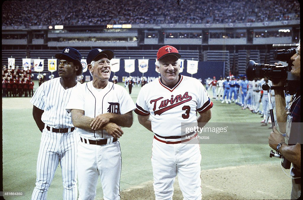 Ricky Henderson #24 of the New York Yankees, Manager Sparky Anderson and Harmon Killebrew #3 of the Minnesota Twins are seen on the base path during player introductions before the 56th Major League Baseball All-Star Game against the National League at the Hubert H. Humphrey Metrodome on Tuesday, July 16, 1985 in Minneapolis, MN. (Photos by MLB Photos ) *** Ricky Henderson; Sparky Anderson; Harmon Killebrew