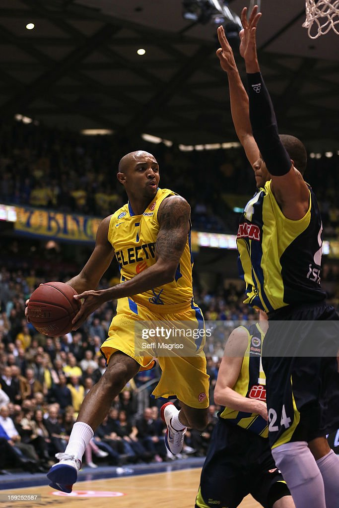 Ricky Hickman, #7 of Maccabi Electra Tel Aviv competes with <a gi-track='captionPersonalityLinkClicked' href=/galleries/search?phrase=Mike+Batiste&family=editorial&specificpeople=784344 ng-click='$event.stopPropagation()'>Mike Batiste</a>, #24 of Fenerbahce Ulker Istanbul during the 2012-2013 Turkish Airlines Euroleague Top 16 Date 3 between Maccabi Electra Tel Aviv v Fenerbahce Ulker Istanbul at Nokia Arena on January 10, 2013 in Tel Aviv, Israel.
