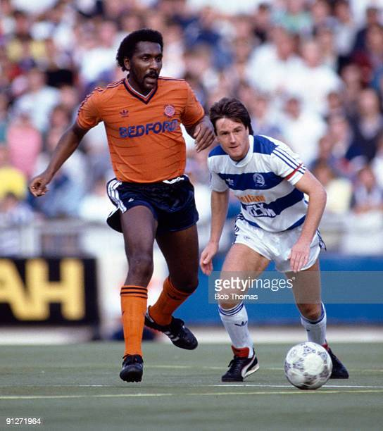 Ricky Hill of Luton Town with Terry Fenwick of Queens Park Rangers during the Queens Park Rangers v Luton Town Division 1 match played at Loftus Road...