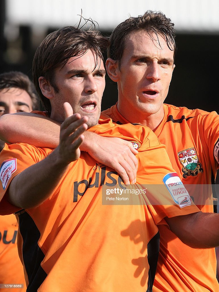 Ricky Holmes of Barnet ( L) is congratulated by teammate Mark Hughes after scoring his sides goal during the npower League two match between Barnet and Northampton Town at Underhill Stadium on October 1, 2011 in Barnet, England.