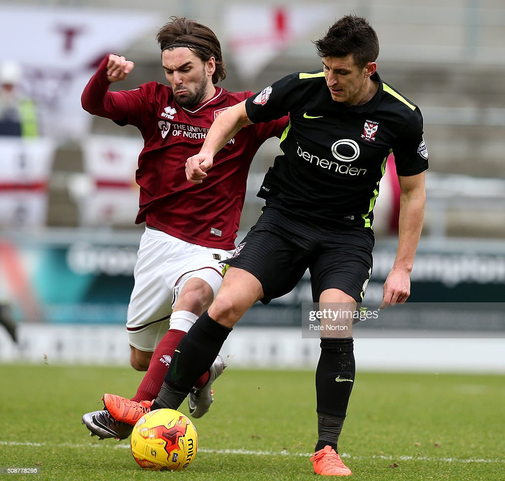 Ricky Holmes of Northampton Town contests the ball with Michael Coulson of York City during the Sky Bet League Two match between Northampton Town and York City at Sixfields Stadium on February 6, 2016 in Northampton, England.
