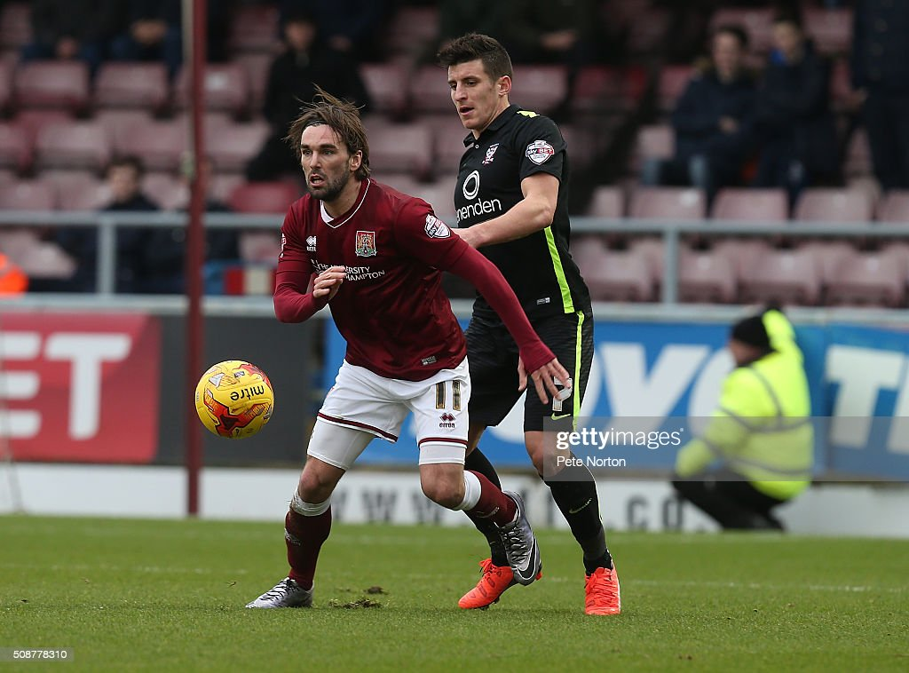 Ricky Holmes of Northampton Town looks to control the ball under pressure from Michael Coulson of York City during the Sky Bet League Two match between Northampton Town and York City at Sixfields Stadium on February 6, 2016 in Northampton, England.