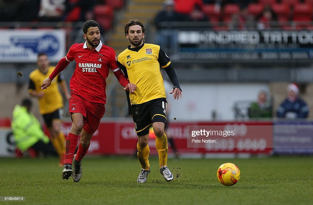 Ricky Holmes of Northampton Town looks to the ball with <a gi-track='captionPersonalityLinkClicked' href=/galleries/search?phrase=Jobi+McAnuff&family=editorial&specificpeople=642949 ng-click='$event.stopPropagation()'>Jobi McAnuff</a> of Leyton Orient during the Sky Bet League Two match between Leyton Orient and Northampton Town at Matchroom Stadium on February 13, 2016 in London, England.
