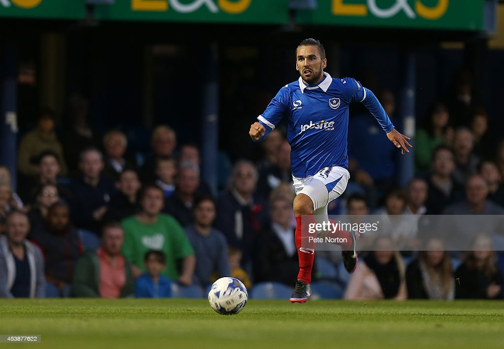 Ricky Holmes of Portsmouth in action during the Sky Bet League Two match between Portsmouth and Northampton Town at Fratton Park on August 19, 2014 in Portsmouth, England.