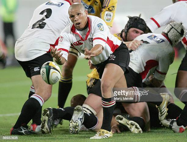 Ricky Januarie of the Cats passes the ball during the Round 3 Super 14 match between the Hurricanes and the Cats played at the Westpac Stadium on...