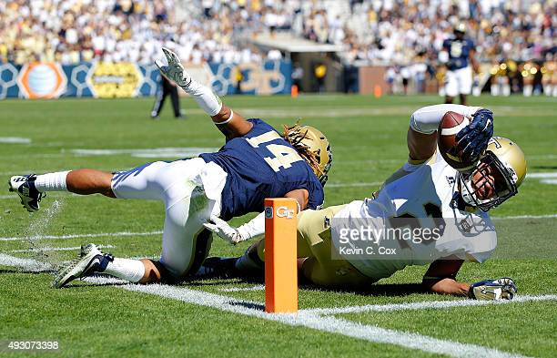 Ricky Jeune of the Georgia Tech Yellow Jackets scores a touchdown as he dives into the end zone away from Avonte Maddox of the Pittsburgh Panthers at...
