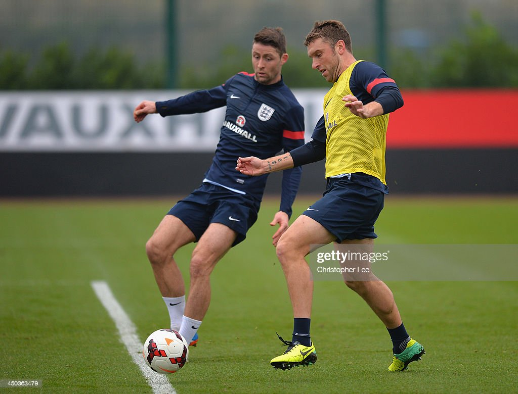 Ricky Lambert and <a gi-track='captionPersonalityLinkClicked' href=/galleries/search?phrase=Gary+Cahill&family=editorial&specificpeople=204341 ng-click='$event.stopPropagation()'>Gary Cahill</a> in action during England Training at London Colney on November 18, 2013 in St Albans, England.