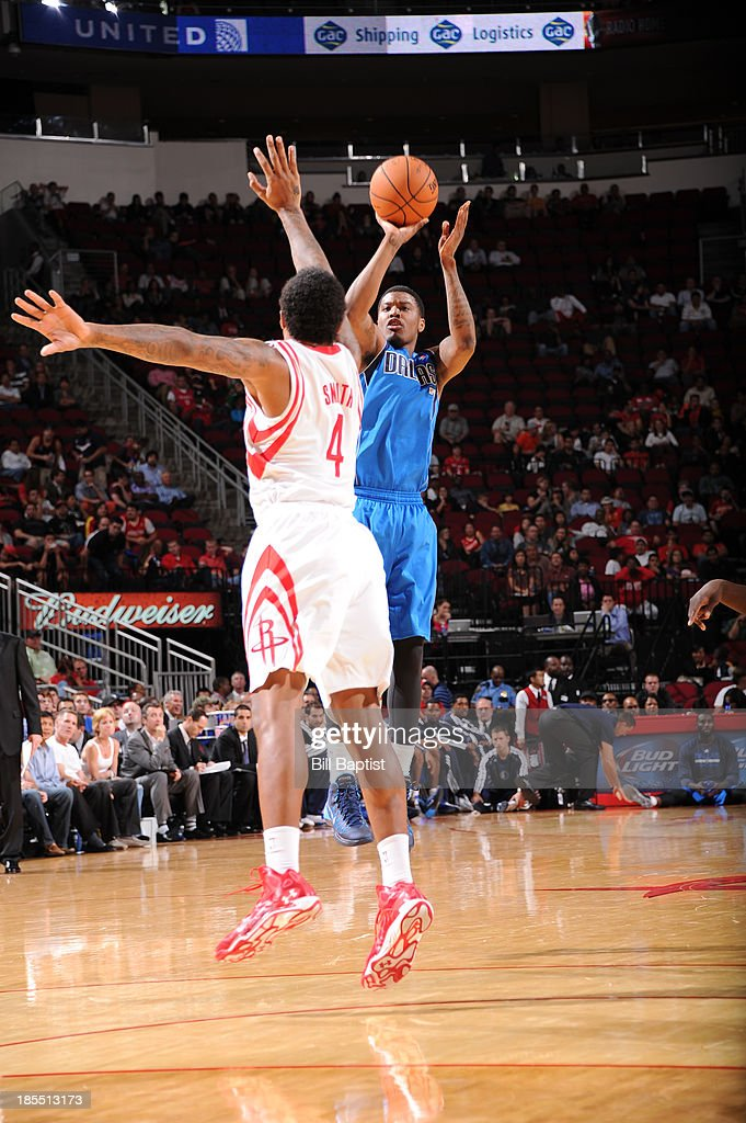 <a gi-track='captionPersonalityLinkClicked' href=/galleries/search?phrase=Ricky+Ledo&family=editorial&specificpeople=10933759 ng-click='$event.stopPropagation()'>Ricky Ledo</a> #7 of the Dallas Mavericks shoots the ball against Greg Smith #4 of the Houston Rockets during a 2013 NBA pre-season game on October 21, 2013 at the Toyota Center in Houston, Texas.