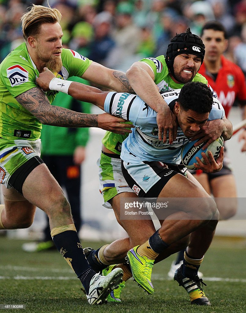 Ricky Leutele of the Sharks is tackled during the round 19 NRL match between the Canberra Raiders and the Cronulla Sharks at GIO Stadium on July 18, 2015 in Canberra, Australia.